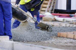 Construction Highway Workers Using Crushed Stone