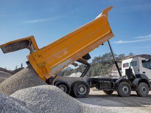 Dump Truck Hauling Gets Rid of Construction Concrete