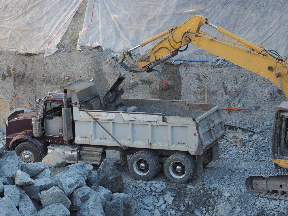 Dump Truck Hauling Heavy Equipment in Baltimore